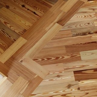 heart pine wood floor and border installation and finishing